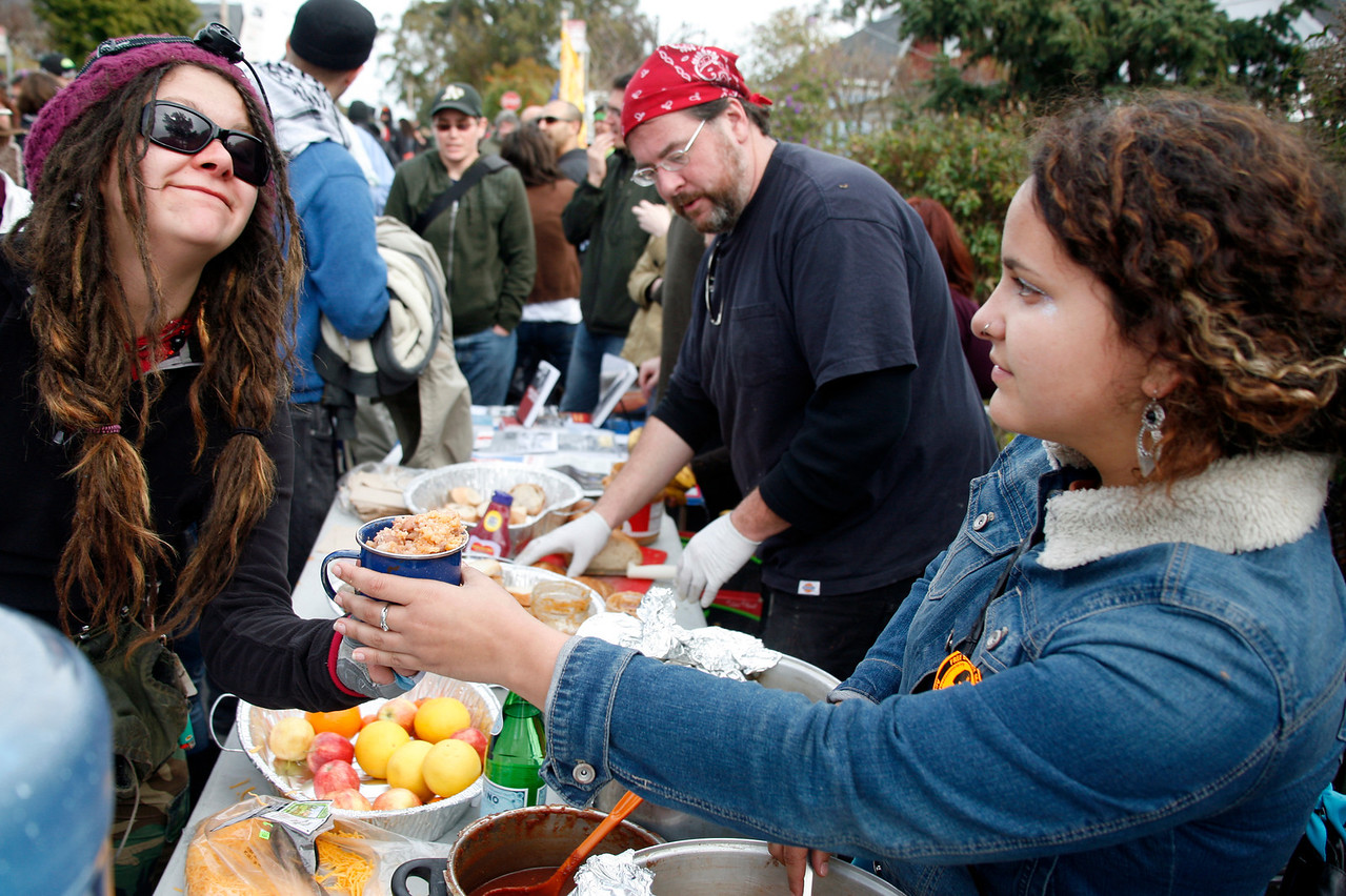 Angel Castellon, right, of the Occupy Oakland kitchen serves one of the hungry prosters near the main gate to San Quentin Prison in San Quentin, Calif. on Monday, February 20, 2012.  (Special to the IJ/James Cacciatore)