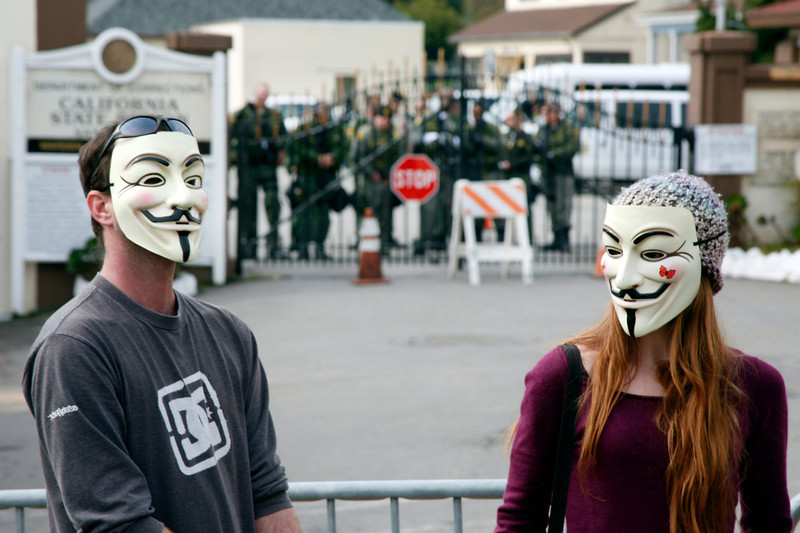 Anonymous masked protesters at the main gate to San Quentin Prison in San Quentin, Calif. on Monday, February 20, 2012.  (Special to the IJ/James Cacciatore)