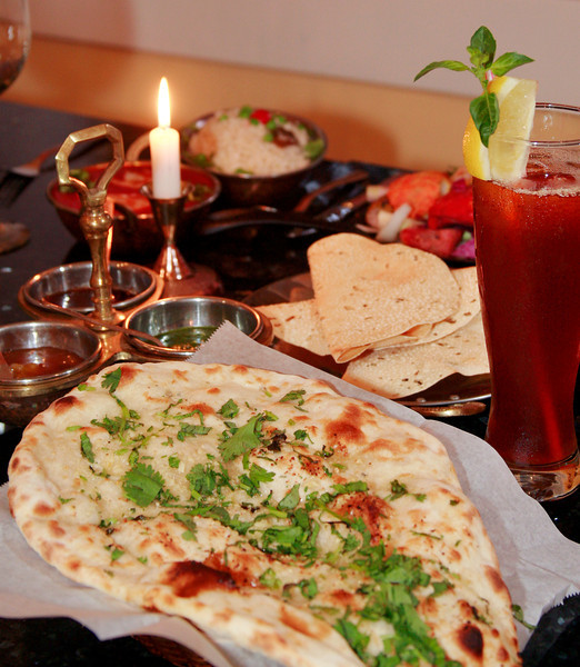 Basil garlic naan served with mint, tamarind and mango chutney sauces along with Papadum and Indian iced tea at Prabh Indian Kitchen on Sunnyside Avenue in Mill Valley, Calif. Wednesday, September 5, 2012. (Special to the IJ/James Cacciatore)
