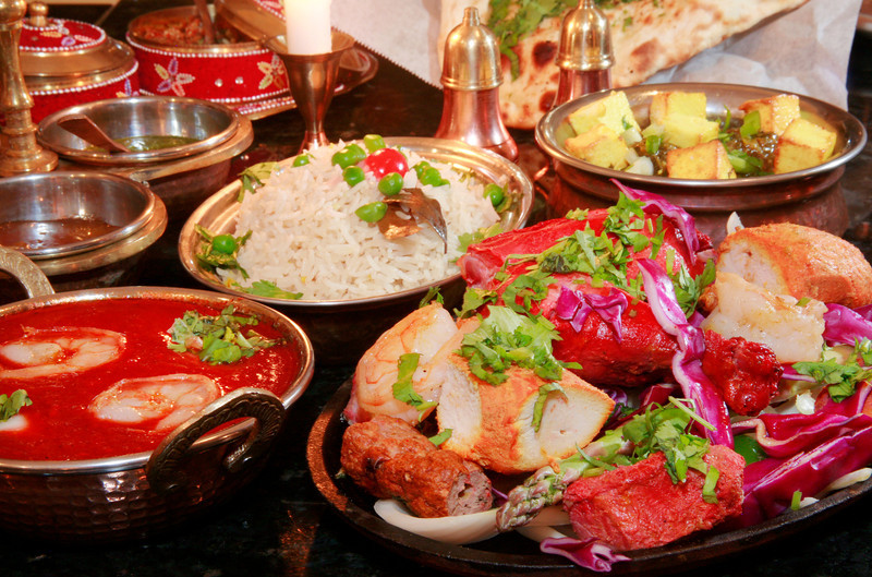 Tandoori mixed grill, bottom right, served with rice also shown are Shrimp Vindaloo and Saag Paneer with cubed homemade cheese on top at the Prabh Indian Kitchen on Sunnyside Avenue in Mill Valley, Calif. Wednesday, September 5, 2012. (Special to the IJ/James Cacciatore)
