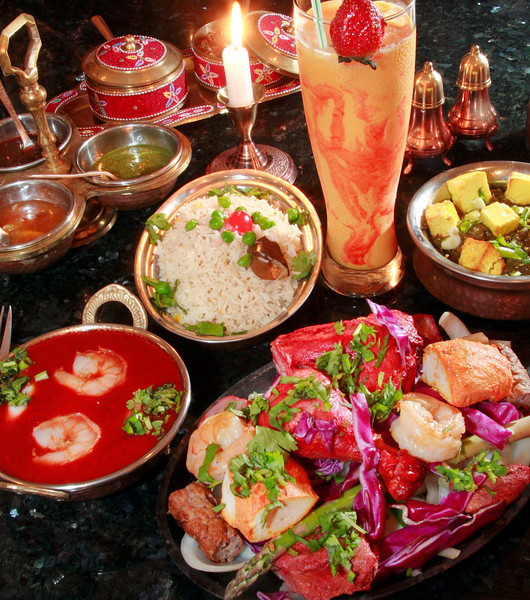 Tandoori mixed grill, bottom right, served with rice is accompanied by a house speciality Mango Lassi beverage also shown are Shrimp Vindaloo and Saag Paneer with cubed homemade cheese on top at the Prabh Indian Kitchen on Sunnyside Avenue in Mill Valley, Calif. Wednesday, September 5, 2012. (Special to the IJ/James Cacciatore)
