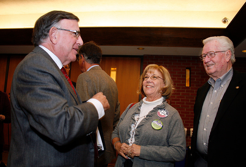 Gary Phillips, left, is congratulated by Helen and Maynard Willms before being sworn in as San Rafael's new mayor at the city hall council chambers in San Rafael, Calif. on Monday, December 5, 2011.  (Special to the IJ/ James Cacciatore)