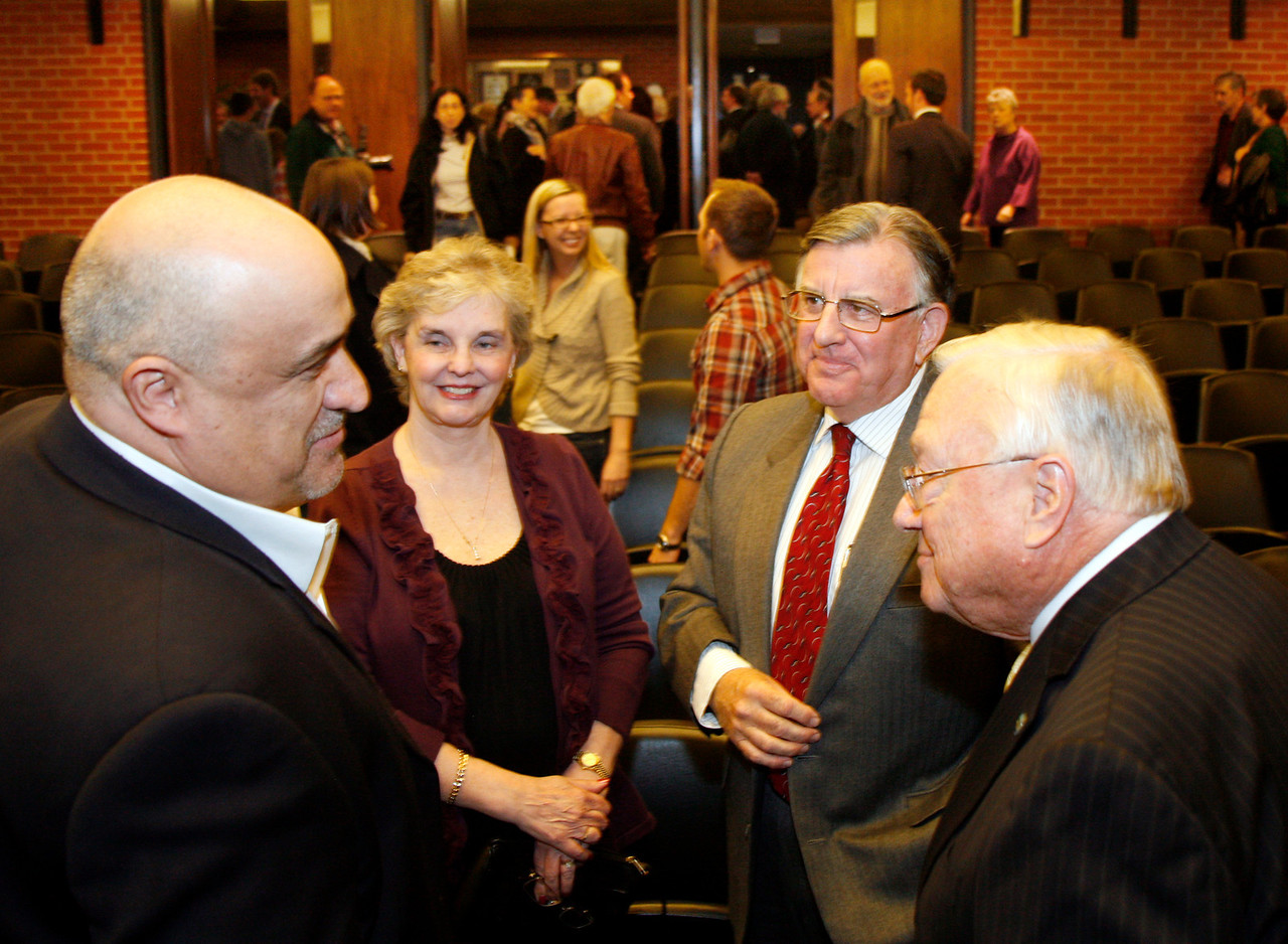 Gary Phillips, second from right, is congratulated by Marty Rubino, left, Linda Phillips and Al Boro after being sworn in as San Rafael's new mayor at the city hall council chambers in San Rafael, Calif. on Monday, December 5, 2011.  (Special to the IJ/ James Cacciatore)