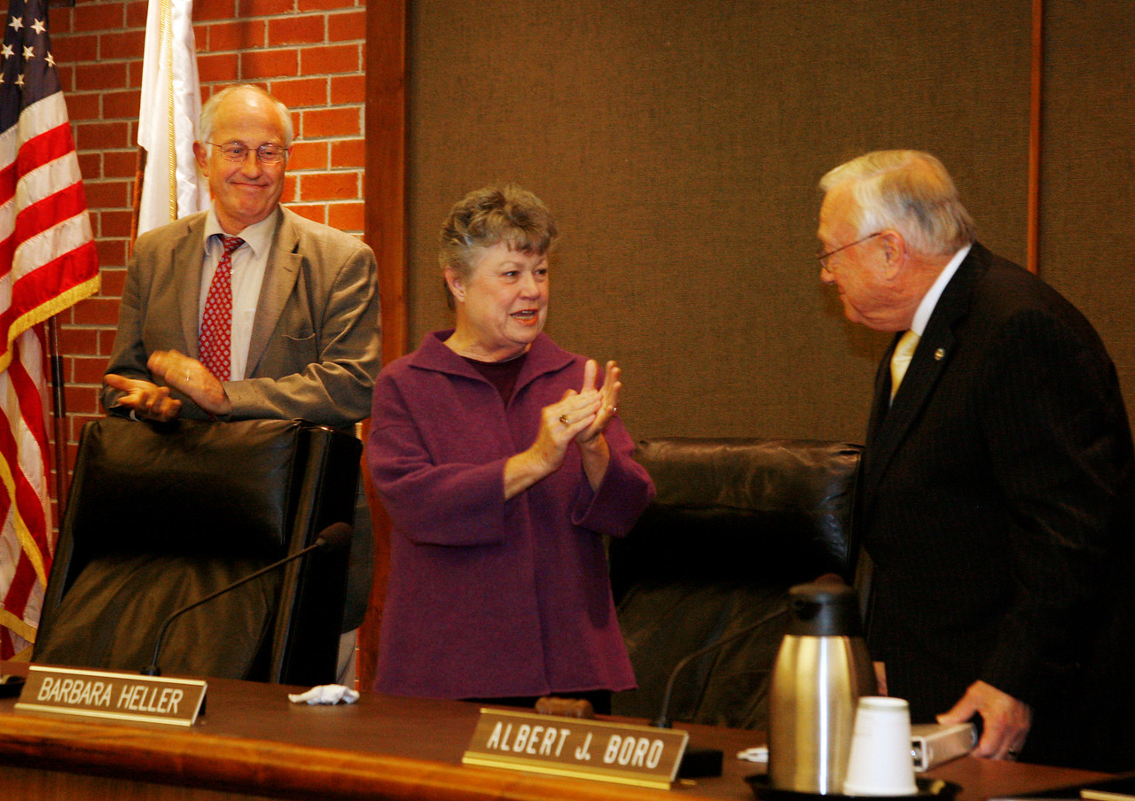 Al Boro, right, gets a sustained round of applause from everyone in attendence , at left, Greg Brookband and Barbara Heller, after dispatching his last official act as Mayor, closing the meeting, at the city hall council chambers in San Rafael, Calif. on Monday, December 5, 2011.  (Special to the IJ/ James Cacciatore)
