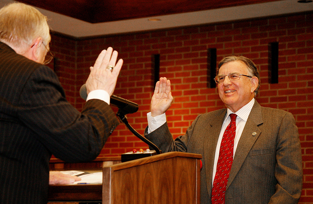Gary Phillips, right, is sworn in by Al Boro as San Rafael's new mayor at the city hall council chambers in San Rafael, Calif. on Monday, December 5, 2011.  (Special to the IJ/ James Cacciatore)
