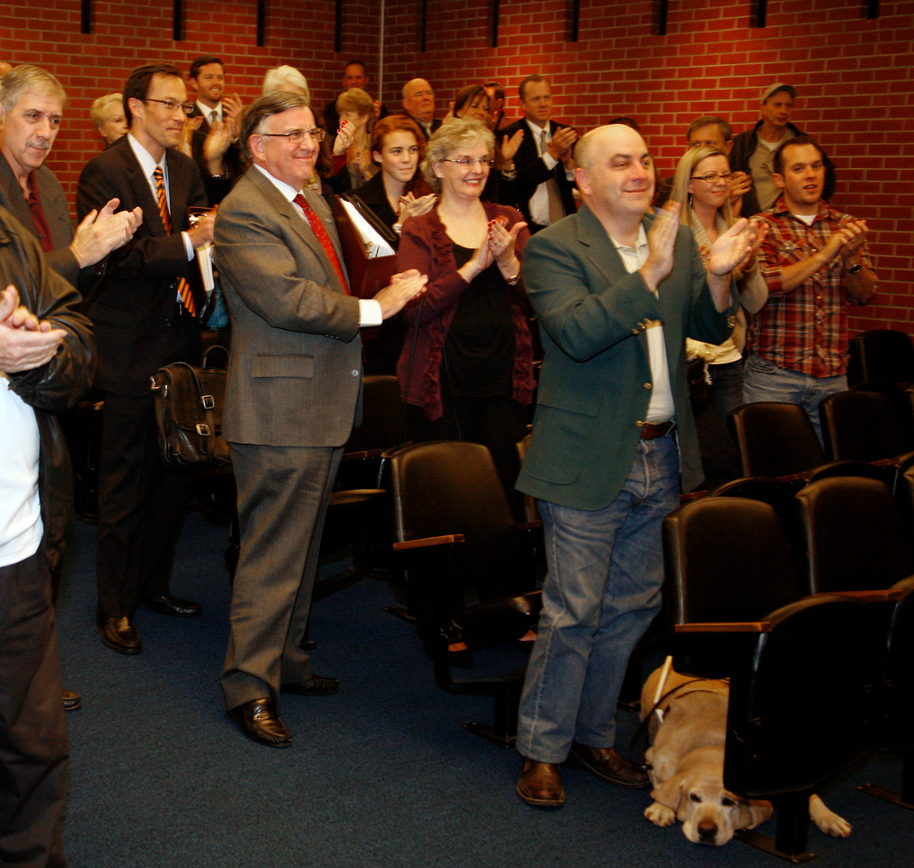 Al Boro gets a sustained round of applause from the gallery after dispatching his last official act as Mayor, closing the meeting, at the city hall council chambers in San Rafael, Calif. on Monday, December 5, 2011.  (Special to the IJ/ James Cacciatore)
