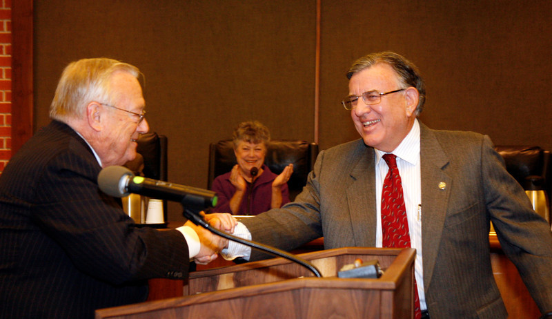 Gary Phillips is congratulated by Al Boro after being sworn in as San Rafael's new mayor at the city hall council chambers in San Rafael, Calif. on Monday, December 5, 2011.  (Special to the IJ/ James Cacciatore)