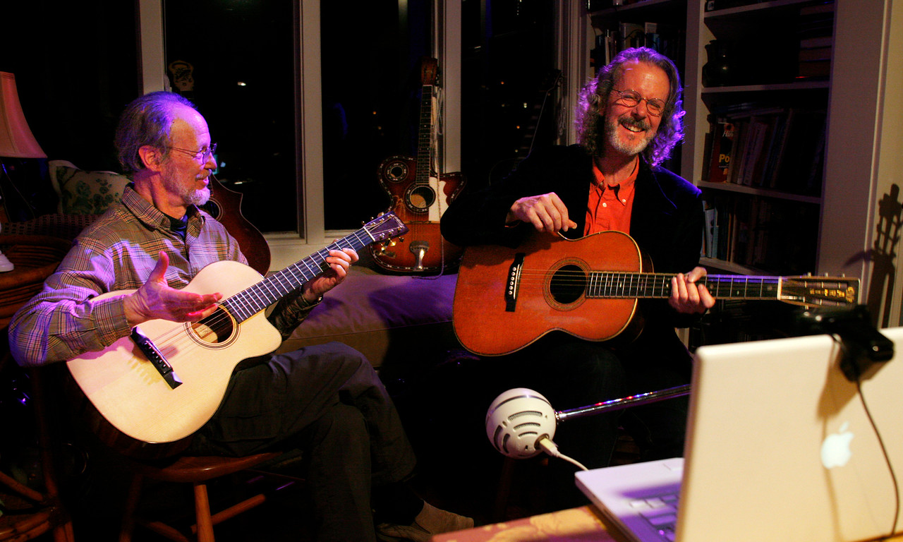 """From his laptop equipped with a high definition webcam and external microphone, Singer-songwriter-guitarist Stevie Coyle, right,  preforms with Eric Schoenberg, left, on his """"Wee Wednesday Webcast"""" from Schoenberg's home in Tiburon, Calif. on Wednesday, February 22, 2012. The two musicians played songs together and separately on a number of vintage guitars for nearly an hour to an audience via Stageit.com. (Special to the IJ/James Cacciatore)"""