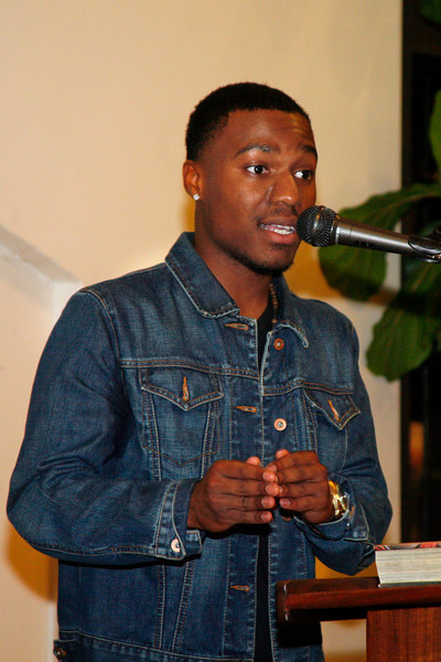 Slam poetry winner Daron Austin, a senior at Tamalpais High School, delivers the winning poem at the First Friday Slam Poetry Competition at the Mill Valley Library in Mill Valley, Calif. on Friday, March 2, 2012. (Special to the IJ/James Cacciatore)