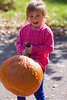 Mia hoists a pumpkin - 2016-10-29
