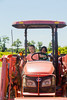 Mia and Tessa on a tractor - 2016-07-02