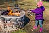 Mia tending to the fire - 2017-03-05