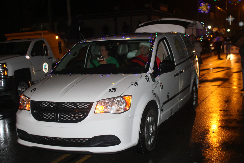 . Despite rainy weather, festive cars, floats and walking groups took part in Marine City\'s Lighted Santa Parade Nov. 21. (Photos by Dave Angell)