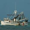 Shrimp boat leaving for its mornings catch.