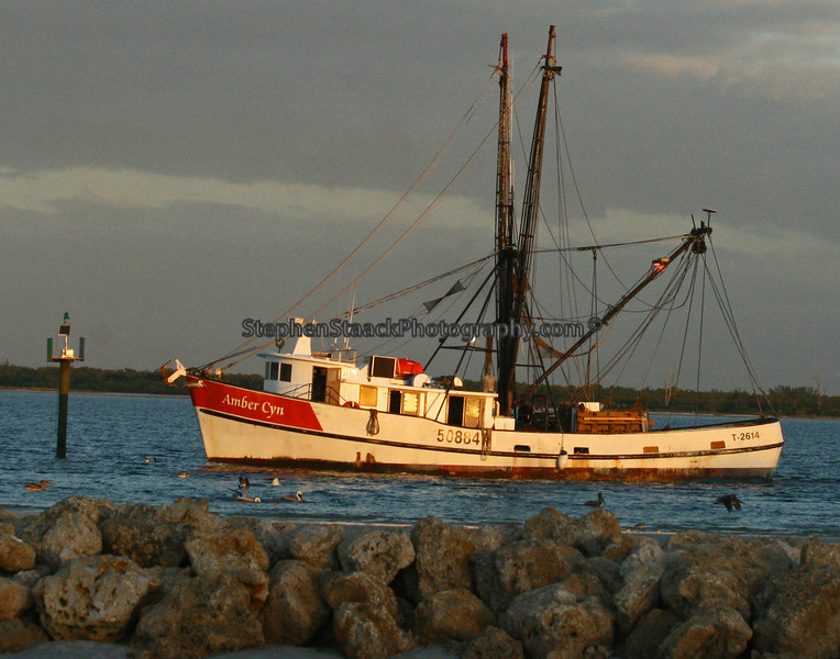 A fishing boat going out to sea.