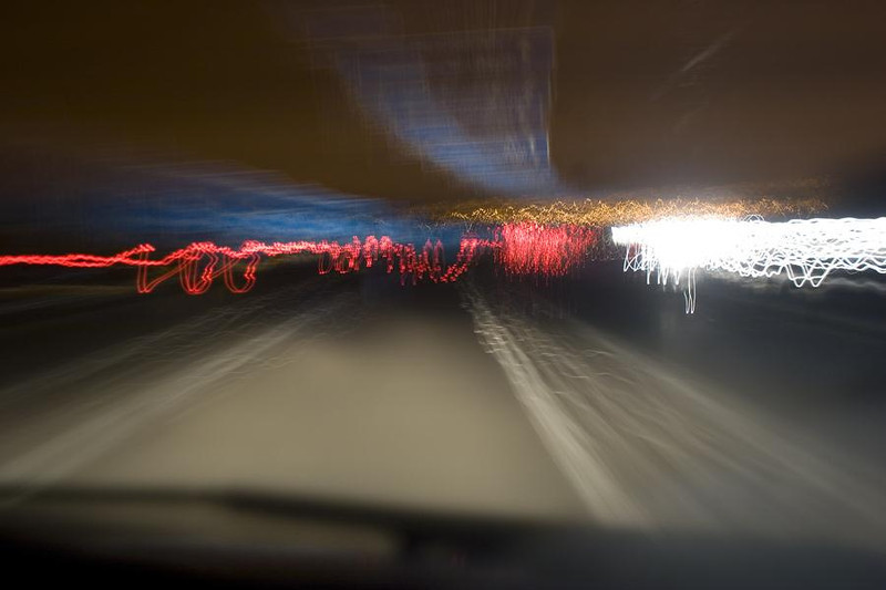 A camera placed on the dashboard of a moving car on a Dual Carraigeway with an open shutter