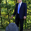 Mark Bodanza of Leominster walks through Pine Grove Cemetery in Leominster on Wednesday afternoon and talks about the people buried their and of his upcoming tour in the cemetery. here he stands next to Peter Joslyn's grave a man that out lived three wives. SENTINEL & ENTERPRISE/JOHN LOVE