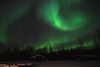 Wild green curved Aurora over cabin - Alaska - Mark Rasmussen