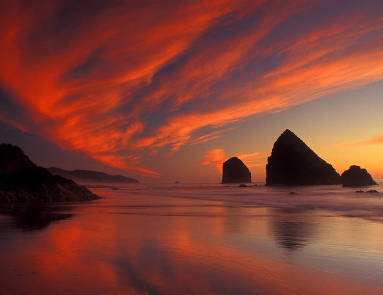 Cannon Beach afire - Haystack Rock - Oregon Islands National Wildlife Refuge,Oregon - Mark Rasmussen