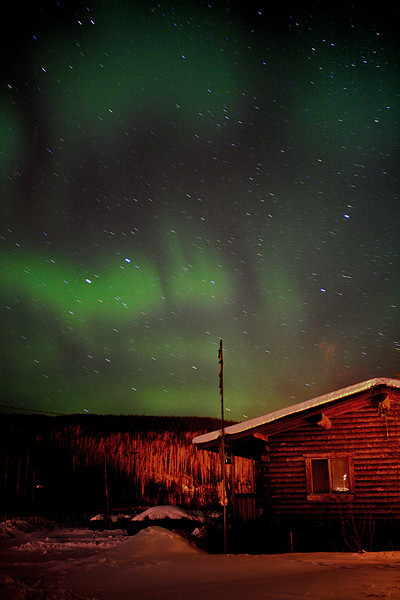 Pulsing green Aurora over cabin - Alaska - Mark Rasmussen