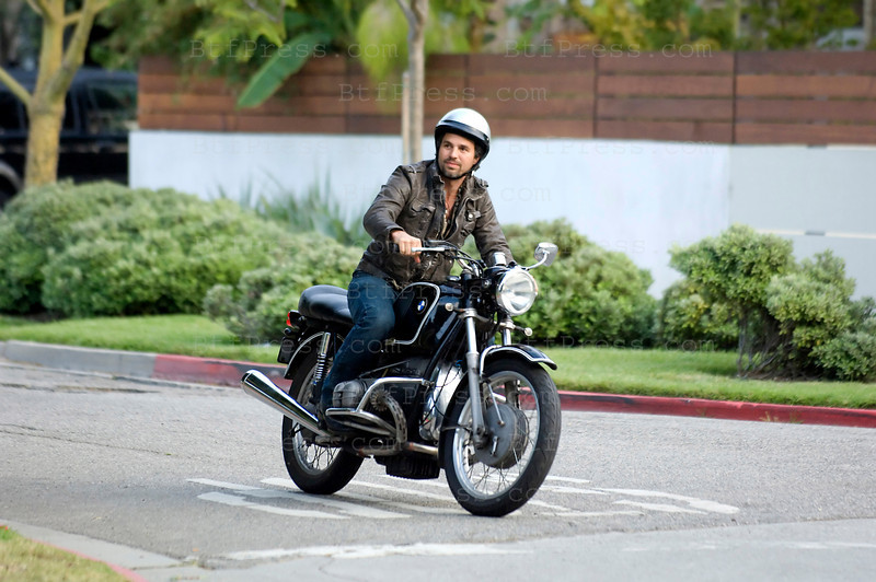 "Mark Ruffalo is driving an old BMW motorcycle during the set of "" The Kids Are All Right "" in Los Angeles California. (Photo by Michel Boutefeu)"