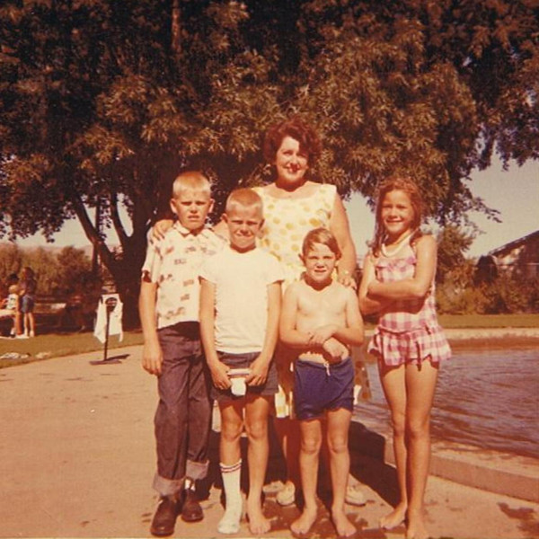 "1963 - Danny Yaden (left, age 9), Mark Yaden (age 7), Pauli Yaden (age 5) - Woman in back and girl to right unknown - Location somewhere in Yakima, WA area<br /> <br /> Note from Mom (Betty Jean Yaden), which was too good not to include:<br /> <br /> Well--it looks like a wading pool--did the Selah park have one?  The gal and girl do look a little familiar but I can't come up with a name--sorry.  But, I will say that the look on your face is pathetic and Mark should be putting that sock on his foot not on his ????.  Maybe Pauli has a clue. Did I help any?<br /> <br /> Sister Pauli:<br /> <br /> That sock looks more like a ""footie"" to me!!"