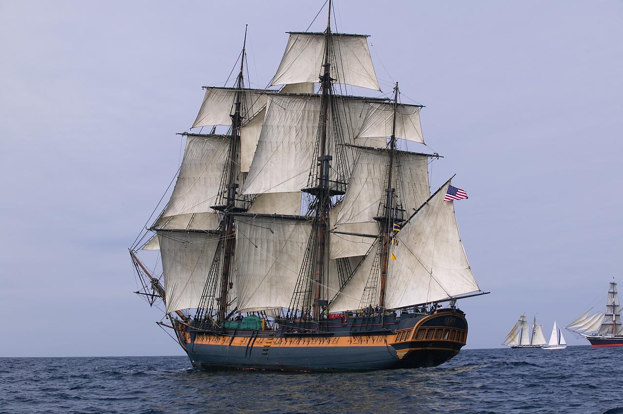 HMS Surprise sailing at sea under full sail