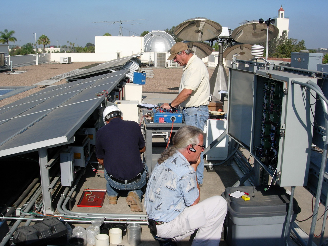 Bill Lekas, SDSU Physical Plant, Monitors the calibration of the 7 solar array data acquisition system.