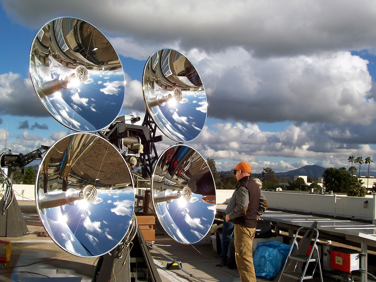 """Mark Morgan of EDTEK Inc, Works on the SDSU Physics roof.."""" solar concentrator photovoltaic and hot water co-generation system"""""""