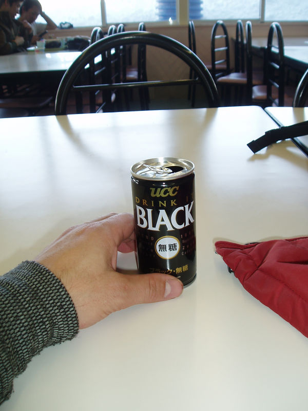 black coffe in a can, hot and straight out of a vending machine!