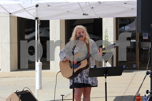 Jacey Gutknecht, a singer-songwriter performs