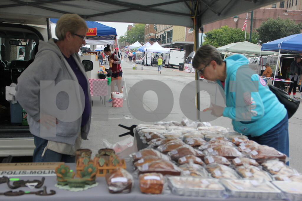 On  Saturday, August 27, 2016, Central Avenue in Fort Dodge was a buzz again with  Market on Central, which offers plenty of vendors and things to see and do  for everyone.  Seen here ( from left to right) is : Deb Jackson and Karen Martens as they look over some bakery goods.