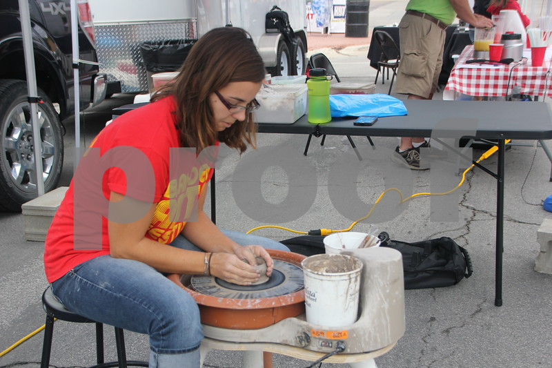 On Saturday, August 27, 2016, Central Avenue in Fort Dodge was a buzz again with Market on Central, which offers plenty of vendors and things to see and do for everyone. Pictured is : Hope Opthier, as she demonstrates how to throw a pot on the potter's wheel.