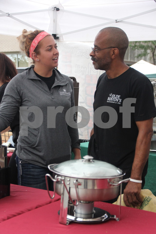 On Saturday, August 27, 2016, Central Avenue in Fort Dodge was a buzz again with Market on Central, which offers plenty of vendors and things to see and do for everyone. Seen pictured (left to right) here is: Nichole Walters and Timothy Moore, one of the food vendors at the event.