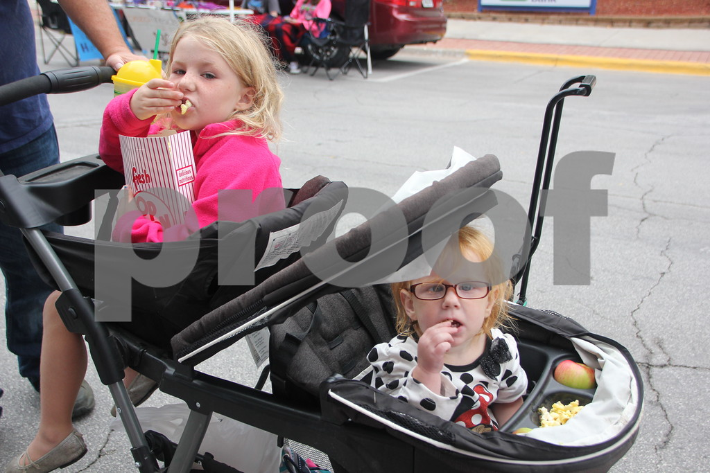 On Saturday, August 27, 2016, Central Avenue in Fort Dodge was a buzz again with Market on Central, which offers plenty of vendors and things to see and do for everyone. Seen here ( from left to right) is : Bella Dorsey and Taylor Dorsey enjoying some snacks while checking out the event.