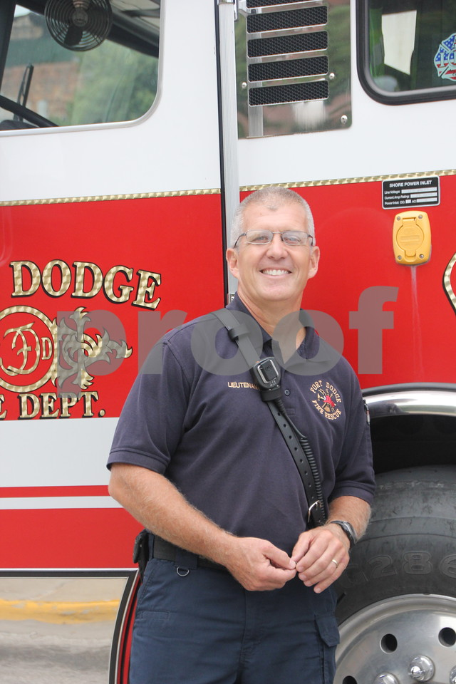 On Saturday, August 27, 2016, Central Avenue in Fort Dodge was a buzz again with Market on Central, which offers plenty of vendors and things to see and do for everyone. Seen here is: Randy Schilling, from the fire department next to the Fort Dodge Fire Department's hook and ladder truck.