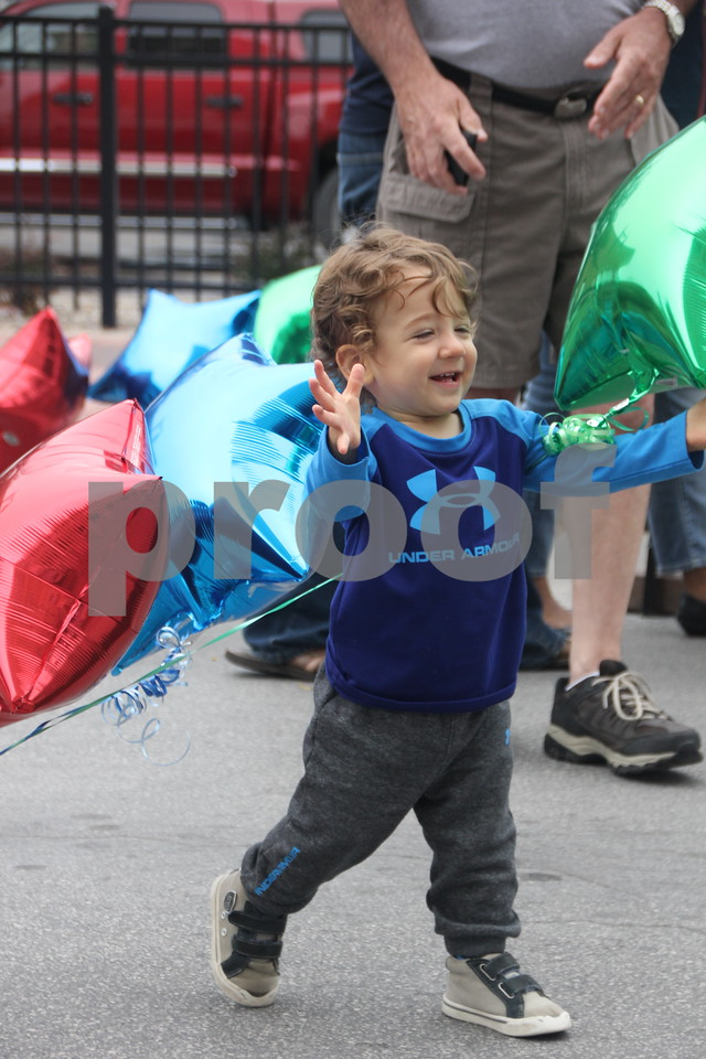On Saturday, August 27, 2016, Central Avenue in Fort Dodge was a buzz again with Market on Central, which offers plenty of vendors and things to see and do for everyone. Seen here is: Drew Sheffield having fun at the event with the balloons.