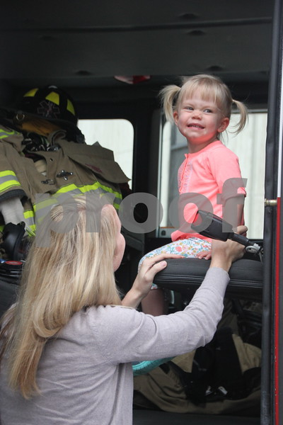 On Saturday, August 27, 2016, Central Avenue in Fort Dodge was a buzz again with Market on Central, which offers plenty of vendors and things to see and do for everyone. Here pictured (left to right) is: Alison Meier(mom) and Elsie Meier checking out the Fort Dodge Fire Department's hook and ladder truck.