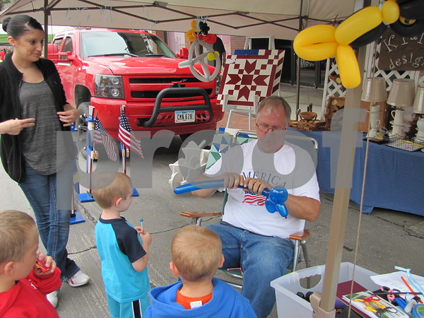 Kevin Davis created balloon animals for children at his booth kp&me Designs which featured wood working, handmade cards, barn quilts, and more.