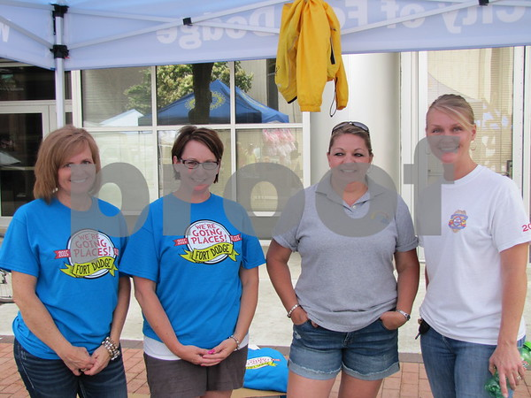Tina Hindman and Angie Tracy of the RAGBRAI committee were encouraging volunteerism for the upcoming visit of RAGBRAI through Fort Dodge. They are shown here with Vicki Reeck and Jamie Anderson with the city of Fort Dodge at the city's fundraising booth.
