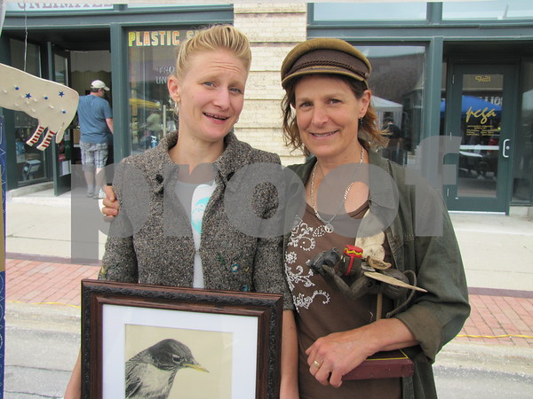 Artists Chelsea Phan of Fort Dodge and Nancy Rodermann of Rockwell City at Market on Central.  Phan creates drawings primarily of various birds and Rodermann creates moveable, musical wood folk art pieces.  Rodermann would love to create custom wood products for your home or yard.