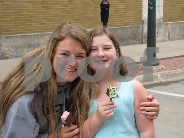 Emma Yenger and cousin Molly Laird enjoyed cheesecake on a stick while watching the pony rides.