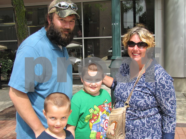 Kelly and Carol Burton with their children Gavin and Braxton were checking out the booths at Market on Central.