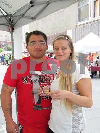 "Mark and Danielle Beascochea enjoyed samples at ""Ericks Enchiladas"" at Market on Central."