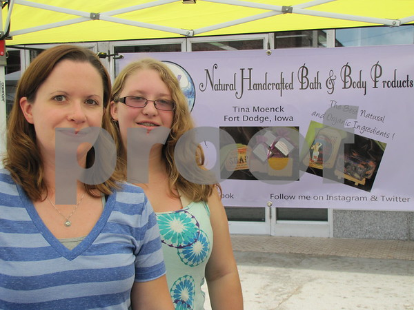 Tina Moenck with her daughter Paige Burger at Moenck's booth at Market on Central.