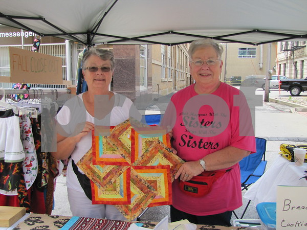 "Sisters Deanne Elbert and Judy Williamson of ""Two Sisters"" in their booth at Market on Central."