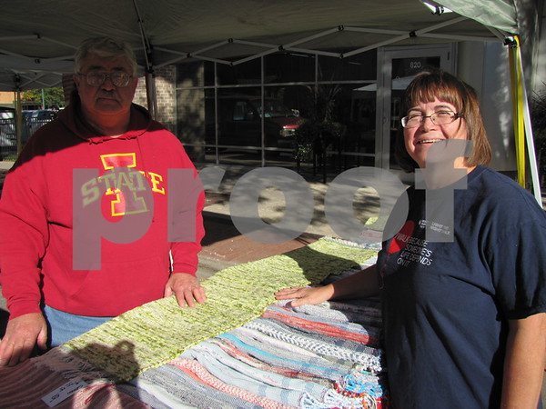 Roxanne Hirsch looks over some of the many rag rugs offered by dennyd.