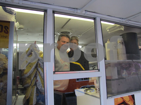 Tony and Mary Sunken working at Terry Cook's trailer serving funnel cakes and more.