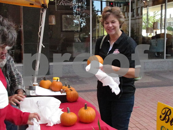 Carol Mann purchased some pumpkins from Black's Heritage Farm at Market on Central.