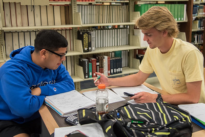 Students Austin Vilanueva and Spencer Swenson work together on their Engineering studies in the Lary and Jeff Bell Library.